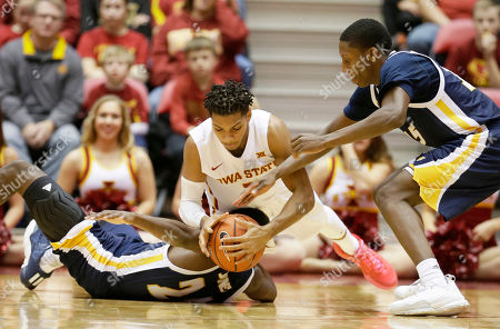 Hallice Cooke, Casey Jones, Eric Robertson Iowa State guard Hallice Cooke, center, fights for a loose ball with Chattanooga's Casey Jones, left, and Eric Robertson, right, during the first half of an NCAA college basketball game, in Ames, Iowa