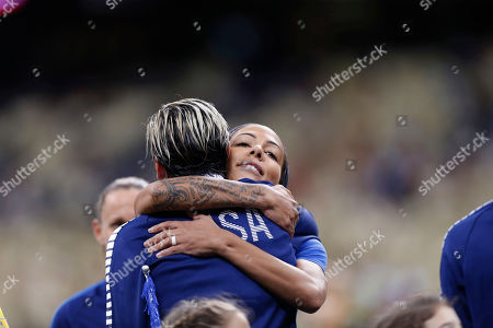 Abby Wambach, Sydney Leroux United States forward Sydney Leroux, facing hugs forward Abby Wambach during a presentation to Wambach before an international friendly soccer match against China in New Orleans, . Wambach retired from international competiton after the game