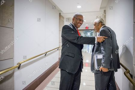Gregory W. Meeks, Charlie Rangel Rep. Gregory W. Meeks, D-N.Y., center, smiles as he has a friendly exchange with Rep. Charlie Rangel, D-N.Y., right, as the two New York lawmakers pass in a basement corridor on Capitol Hill in Washington