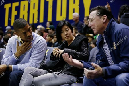 Kevin Johnson, Michelle Rhee, Bob Melvin Sacramento mayor Kevin Johnson, left, his wife Michelle Rhee, center, chat with Oakland Athletics manager Bob Melving duringan NCAA college basketball game between the California and Coppin State, in Berkeley, Calif