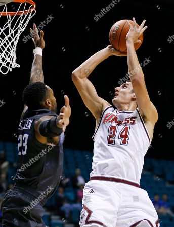 Massachusetts forward Seth Berger (24) shoots over Creighton guard James Milliken (23) during the first half of an NCAA college basketball game, in Las Vegas