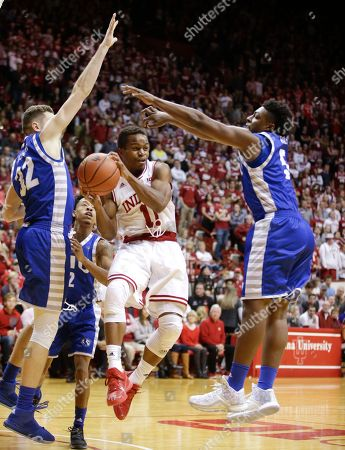 Yogi Ferrell, Patrick Muldoon, A.J. Riley Indiana's Yogi Ferrell (11) makes a pass against Eastern Illinois' Patrick Muldoon (32) and A.J. Riley (5) during the second half of an NCAA college basketball game, in Bloomington, Ind. Indiana won 88-49