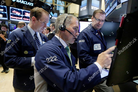 Stock Image of Michael Smyth, Timothy Nick, Patrick King Traders Michael Smyth, left, and Timothy Nick, center, work at the post of specialist Patrick King on the floor of the New York Stock Exchange, . Stocks are slightly higher in early trading as investors look ahead to a busy week of economic reports and central bank meetings