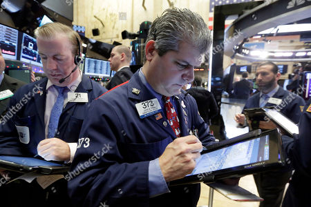 James Doherty, John Panin Traders James Doherty, left, and John Panin, center, work on the floor of the New York Stock Exchange, . Stocks are posting solid gains Friday morning after the U.S. government reported another month of strong job gains
