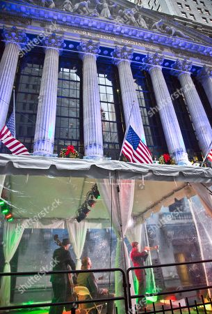 Stock Photo of Trumpeter Michael Arenella and His Dreamland Orchestra preforms during ceremonies for the 92nd annual lighting after trading at the New York Stock Exchange Christmas tree, in New York. Global markets sank Thursday after the European Central Bank announced stimulus plans that came up short of what investors had forecast