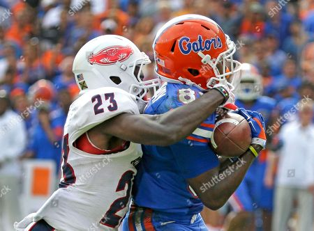 Antonio Callaway, Raekwon Williams Florida wide receiver Antonio Callaway, right, makes a catch for a 53-yard touchdown as Florida Atlantic defensive back Raekwon Williams (23) defends during the second half of an NCAA college football game, in Gainesville, Fla. Florida won in overtime 20-14