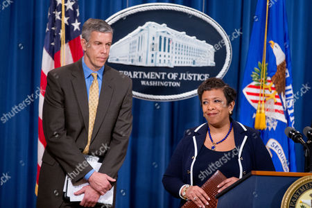 Loretta Lynch, Arne Duncan Attorney General Loretta Lynch, right, accompanied by Education Secretary Arne Duncan, left, steps away from the podium following a news conference at the Justice Department in Washington, where a major federal and state civil litigation settlement concerning Educational Management Corp., a Pittsburgh-based company that runs for-profit trade schools was announced