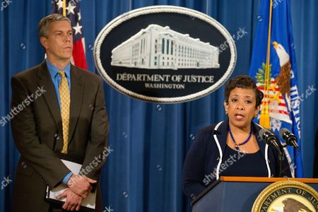 Loretta Lynch, Arne Duncan Attorney General Loretta Lynch, accompanied by Education Secretary Arne Duncan, speaks at a news conference at the Justice Department in Washington, to announce a major federal and state civil litigation settlement concerning Educational Management Corp., a Pittsburgh-based company that runs for-profit trade schools. Lynch also commented about the recent attacks in Paris, France