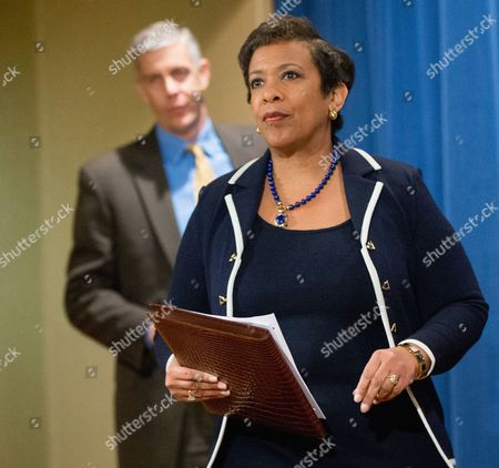 Stock Photo of Loretta Lynch, Arne Duncan Attorney General Loretta Lynch, accompanied by Education Secretary Arne Duncan, arrives to speak at a news conference at the Justice Department in Washington, to announce a major federal and state civil litigation settlement concerning Educational Management Corp., a Pittsburgh-based company that runs for-profit trade schools. Lynch also commented about the recent attacks in Paris, France and security concerns in the United States