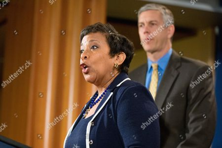 Stock Image of Loretta Lynch, Arne Duncan Attorney General Loretta Lynch, accompanied by Education Secretary Arne Duncan, speaks at a news conference at the Justice Department in Washington, to announce a major federal and state civil litigation settlement concerning Educational Management Corp., a Pittsburgh-based company that runs for-profit trade schools. Lynch also commented about the recent attacks in Paris, France and security concerns in the United States