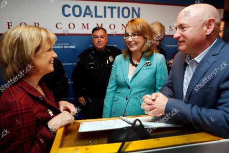 """Dr. Susan Lynch, left, talks with Capt. Mark Kelly, and his wife, former Congresswoman Gabrielle Giffords, after they announced the need for the """"Granite State Coalition for Common Sense"""" during a news conference in Concord, N.H. The coalition wants to close loopholes that allow felons, domestic abusers and the dangerously mentally ill buy guns without undergoing criminal background checks"""