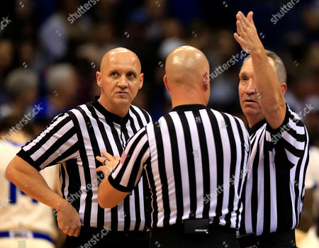 Stock Photo of Joe DeRosa, Bret Smith, Kipp Kissinger Referee Joe DeRosa, right, awards the ball to Holy Cross after conferring with officials Bret Smith, left, and Kipp Kissinger, center, during the first half of an NCAA college basketball game against Kansas in Lawrence, Kan