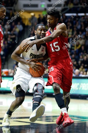 Rapheal Davis, Damon Collins Howard guard Damon Collins (15) tries to get around Purdue guard Rapheal Davis (35) in the first half of an NCAA college basketball game in West Lafayette, Ind