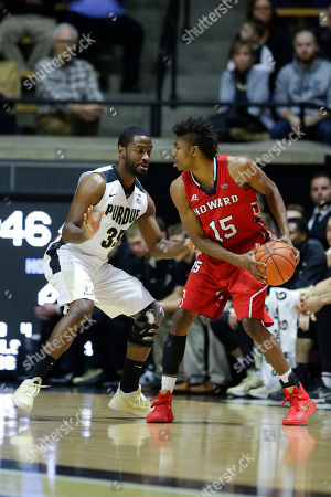 Rapheal Davis, Damon Collins Purdue guard Rapheal Davis (35) defends Howard guard Damon Collins (15) in the first half of an NCAA college basketball game in West Lafayette, Ind
