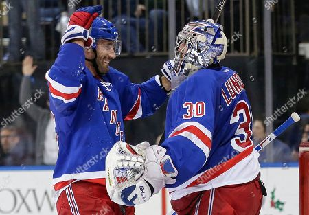 Henrik Lundqvist, Jarret Stoll New York Rangers' Jarret Stoll (26) celebrates with goalie Henrik Lundqvist (30), of Sweden, during an NHL hockey game, in New York. The Rangers won 4-3