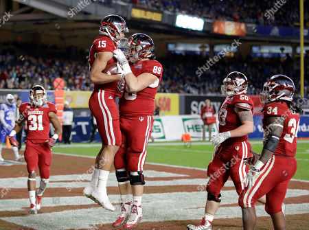 Nick Westbrook, Brandon Knight Indiana's Nick Westbrook (15), second from left, celebrates his touchdown with Indiana's Brandon Knight (89) during the second half of the Pinstripe Bowl at Yankee Stadium in New York, . Duke defeated Indiana 44-41
