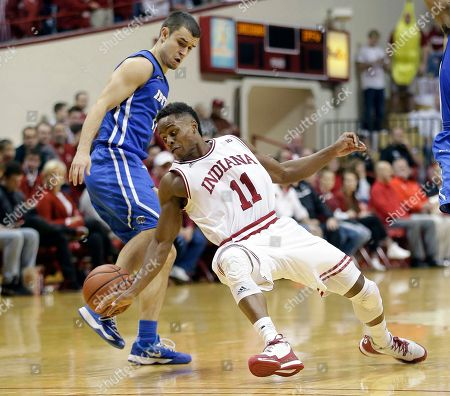 Yogi Ferrell, Max Landis Indiana's Yogi Ferrell (11) is defended by IPFW's Max Landis (10) during the second half of an NCAA college basketball game, in Bloomington, Ind. Indiana won 90-65