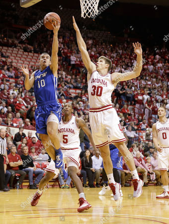 Max Landis, Collin Hartman IPFW's Max Landis (10) puts up a shot against Indiana's Collin Hartman (30) during the first half of an NCAA college basketball game, in Bloomington, Ind