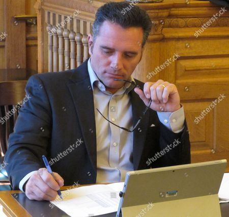 Kansas Senate Ways and Means Committee Chairman Ty Masterson, R-Andover, reviews requests from school districts for emergency aid, at the Statehouse in Topeka, Kan. Masterson, other top legislative leaders and Gov. Sam Brownback have approved $4.2 million in emergency aid