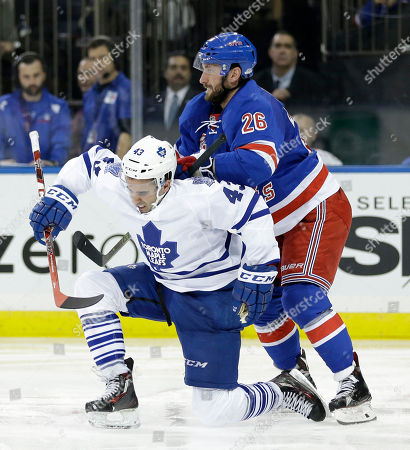 Jarret Stoll, Nazem Kadri New York Rangers' Jarret Stoll, right, pushes Toronto Maple Leafs' Nazem Kadri onto the ice during the third period of the NHL hockey game, in New York. The Rangers won 4-3