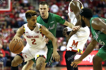 Melo Trimble, Stevie Browning, Ryan Taylor Maryland guard Melo Trimble (2), left, drives the ball against Marshall guard Stevie Browning (2), second from left and forward Ryan Taylor (25), right, in the first half of an NCAA college basketball game, in College Park, Md