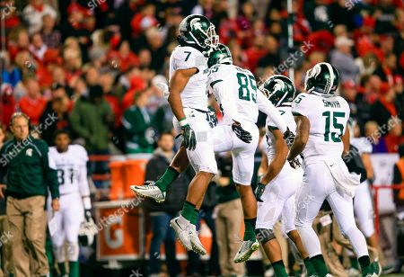 Demetrious Cox, Evan Jones Michigan State defensive back Demetrious Cox (7) celebrates with teammate defensive end Evan Jones (85) after he intercepted a throw by Nebraska quarterback Tommy Armstrong Jr. during the first half of an NCAA college football game in Lincoln, Neb