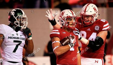 Jordan Westerkamp, Sam Cotton, Demetrious Cox Nebraska wide receiver Jordan Westerkamp, center, is congratulated by teammate tight end Sam Cotton (84) after catching a touchdown pass as Michigan State defensive back Demetrious Cox (7) watches during the first half of an NCAA college football game in Lincoln, Neb