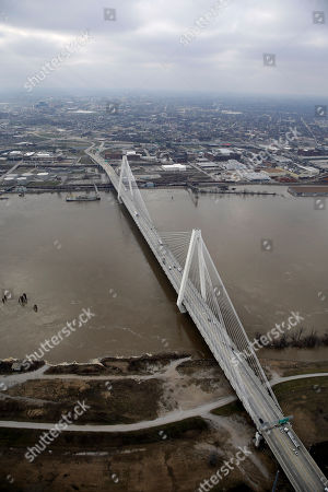In this aerial photo, the Stan Musial Veterans Memorial Bridge crosses a swollen Mississippi River, in St. Louis. A rare winter flood threatened nearly two dozen federal levees in Missouri and Illinois on Wednesday as rivers rose, prompting evacuations in several places