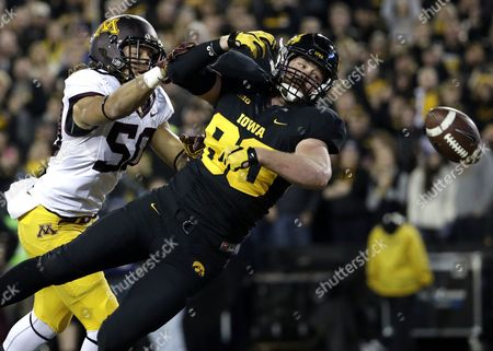 Henry Krieger Coble, Jack Lynn Iowa tight end Henry Krieger Coble, right, is unable to make a catch against Minnesota linebacker Jack Lynn during the first half of an NCAA college football game, in Iowa City, Iowa