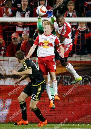 Stock Picture of Steve Clark, Dax McCarty, Ronald Zubar Columbus Crew goalkeeper Steve Clark, back, clears the ball as New York Red Bulls' Dax McCarty, center, and Ronald Zubar, right, go up for the challenge during the second half of the second leg of the MLS soccer Eastern Conference championship, in Harrison, N.J