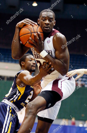 Travis Daniels, Jordan Wilson Mississippi State guard Travis Daniels (23) protects a rebound as Northern Colorado guard Jordan Wilson (25) tries to steal it during the second half of an NCAA college basketball game in Jackson, Miss., . Mississippi State won 93-69