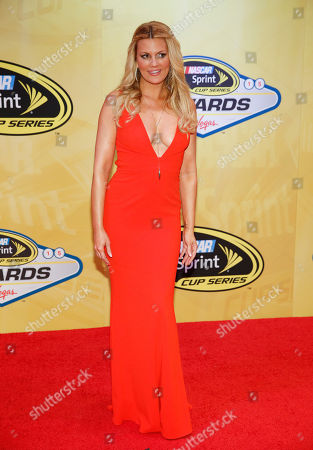 Courtney Hansen poses on the red carpet before the NASCAR Sprint Cup Series auto racing awards, in Las Vegas