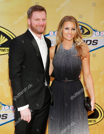 Dale Earnhardt Jr. and his fiancee, Amy Reimann, pose on the red carpet before the NASCAR Sprint Cup Series auto racing awards, in Las Vegas