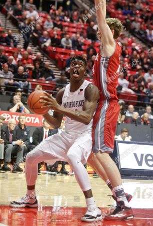 Stock Picture of Zylan Cheatham, Liam Thomas San Diego State forward Zylan Cheatham works for a shot while being guarded by Nicholls State center Liam Thomas in the second half of a NCAA basketball game won by San Diego State 84-47, in San Diego