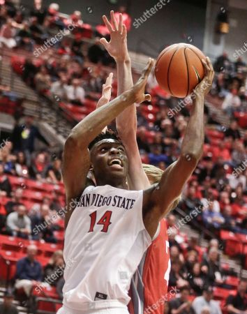 Stock Photo of Zylan Cheatham, Liam Thomas San Diego State forward Zylan Cheatham gets hit in the head by Nicholls State center Liam Thomas while trying to get a shot off in the second half of a NCAA basketball game, in San Diego