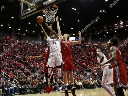 Jeremy Hemsley, Liam Thomas, Johnathan Bell San Diego State guard Jeremy Hemsley scores against Nicholls State center Liam Thomas, right, and guard Johnathan Bell in the first half of a NCAA basketball game, in San Diego