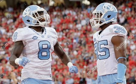 Stock Picture of T.J. Logan, Damien Washington North Carolina's T.J. Logan (8) and Damien Washington (35) celebrate Logan's touchdown against North Carolina State during the first half an NCAA college football game in Raleigh, N.C., . North Carolina won 45-34