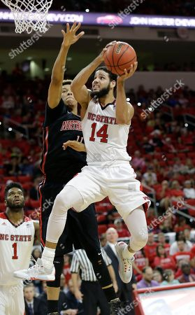 Caleb Martin, Jeremy Miller North Carolina State' Caleb Martin (14) drives to the basket against Northeastern's Jeremy Miller during the first half of an NCAA college basketball game in Raleigh, N.C