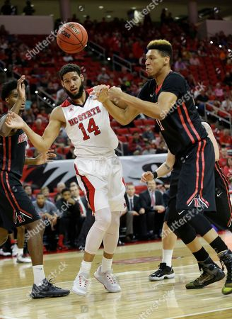 Caleb Martin, Jeremy Miller North Carolina State's Caleb Martin (14) and Northeastern's Jeremy Miller (11) chase the ball during the first half of an NCAA college basketball game in Raleigh, N.C