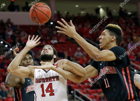 Caleb Martin, Jeremy Miller North Carolina State's Caleb Martin (14) and Northeastern's Jeremy Miller (11) reach for a rebound during the first half of an NCAA college basketball game in Raleigh, N.C