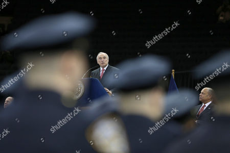 Stock Image of Jeh Johnson, William J. Bratton Secretary of Homeland Security Jeh Johnson, right, listens as New York City Police Commisioner William J. Bratton speaks during the Police Academy graduation ceremony, at Madison Square Garden in New York