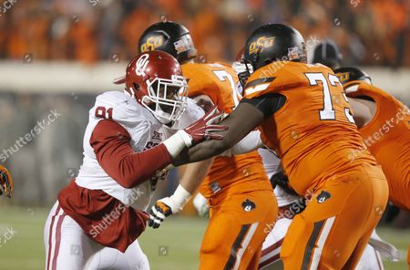 Charles Tapper, Victor Salako Oklahoma defensive end Charles Tapper (91) and Oklahoma State offensive lineman Victor Salako (73) are pictured during an NCAA college football game between Oklahoma and Okalhoma State in Stillwater, Okla., . Oklahoma won 58-23