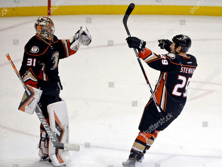 Anaheim Ducks right wing Chris Stewart, who scored the game-winning goal in a shoot out against the Florida Panthers, celebrates with goalie Frederik Andersen in an NHL hockey game, in Anaheim, Calif. Anaheim won 3-2