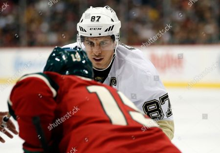 Sidney Crosby, Jarret Stoll Pittsburgh Penguins center Sidney Crosby (87) prepares for a faceoff against Minnesota Wild center Jarret Stoll (19) in the second period of an NHL hockey game, in St. Paul, Minn