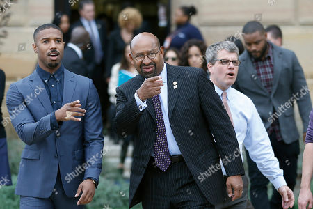 """Michael B. Jordan, Michael Nutter Actor Michael B. Jordan, left, and Philadelphia Mayor Michael Nutter gesture as they walk to a press conference promoting the film """"Creed"""" outside the Philadelphia Museum of Art, in Philadelphia"""