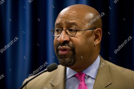 Philadelphia Mayor Michael Nutter speaks during a news conference, in Philadelphia. Justice Department officials are praising the Philadelphia Police Department for its progress in implementing reforms after a federal probe on deadly force. The report issued in May found the department's use of deadly force was motivated by fear and affected mostly black citizens