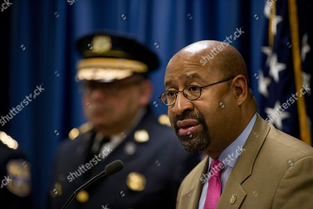 Philadelphia Police Commissioner Charles Ramsey, left, listens to Mayor Michael Nutter during a news conference, in Philadelphia. Justice Department officials are praising the Philadelphia Police Department for its progress in implementing reforms after a federal probe on deadly force. The report issued in May found the department's use of deadly force was motivated by fear and affected mostly black citizens