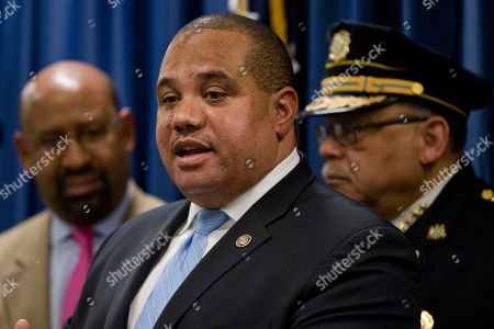 Philadelphia Police Commissioner Charles Ramsey, right, and Mayor Michael Nutter, left, listen to Department of Justice's Ronald Davis, director of the Office of Community Oriented Policing Services (COPS) speak during a news conference, in Philadelphia. Justice Department officials are praising the Philadelphia Police Department for its progress in implementing reforms after a federal probe on deadly force. The report issued in May found the department's use of deadly force was motivated by fear and affected mostly black citizens