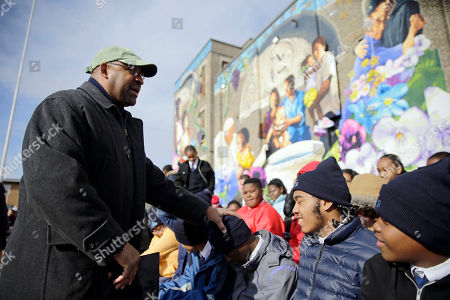 """Philadelphia Mayor Michael Nutter greets students at a ceremony dedicating The City of Philadelphia Mural Arts Program's mural, titled """"The Sacred Now: Faith and Family in the 21st Century,"""", in Philadelphia. Organizers are hoping the mural featuring Pope Francis is eligible for the Guinness World Record for """"Most Contributions to a Painting by Numbers."""" More than 2,700 people, including the pontiff himself, helped create the multistory artwork"""