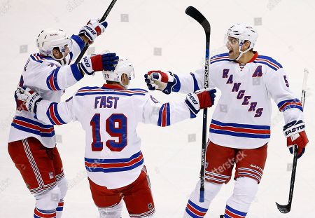 Jesper Fast, Dan Girardi, Jarret Stoll New York Rangers' Jesper Fast (19), of Sweden, celebrates his goal against the Arizona Coyotes with Dan Girardi (5) and Jarret Stoll, left, during the first period of an NHL hockey game, in Glendale, Ariz